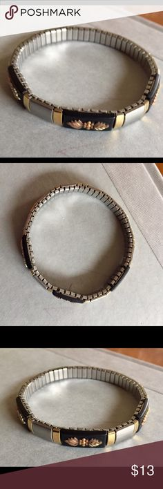 Vintage black hills gold stainless bracelet Stainless steal stretch bracelet with what appears to be black hills gold flowers. Great condition. Vintage Jewelry Bracelets