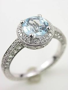 "Engagement Ring Inspiration: ""Consider choosing a colored stone. It's not for every girl, but this light blue aquamarine is a beautiful and unexpected twist on popular Vintage Halo Style Engagement Rings."" ~ Sarah of Luck Photography"