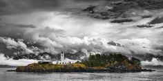 A very nice photo of a storm brewing behind the Five Finger Island Lighthouse.