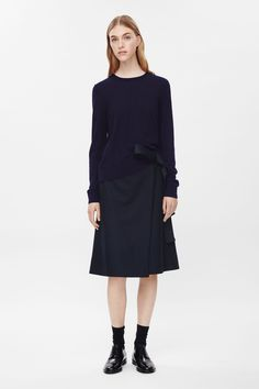 COS image 1 of Round-neck wool jumper in Indigo