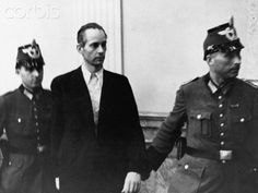 Peter Graf Yorck von Wartenburg is lead to his trial in Plotzensee prison by police officers. He was accused of taking part in the attempt on Adolf Hitler's life, found guilty and executed, all in the same day. | Location: near Berlin, Germany. August 07, 1944.