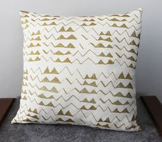 I know where I am getting my pillows from now...LOVE! Hand Printed 'Mountain' Pillow in Gold on Creme by thiefandbandit, $28.00