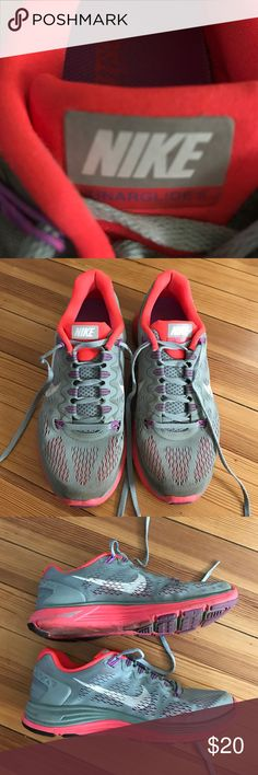 Nike Lunarglide 5 running sneakers Gray sneakers with fun hot coral pink and purple accents.  The Lunarglide 5 sneakers by Nike are amazingly supportive for both short and long runs. This is still my favorite running sneaker style - I buy a new pair each year!  Very good used condition with plenty of miles left in them. Some wear on the treads as noted in the pictures. Nike+ compatible. Reasonable offers considered. Nike Shoes Sneakers