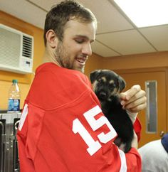 Riley Sheahan and Hector, a puppy from the Michigan Humane Society (Source: redwings.nhl.com)