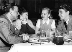 Ronald Reagan and his first wife actress Jane Wyman (on right)are seen here in this March 17, 1946 file photo dining at the Brown Derby restaurant in Hollywood, California with fellow actors George Burns and his wife Gracie Allen