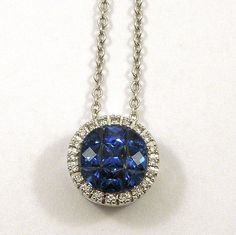 0.90 Carats of Sapphires Surrounded by a 0.06 Carat Diamond Halo set in an 18k White Gold Pendant with Chain. $1,850