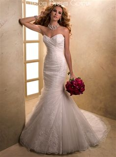 Graceful Fit and Flare Gown with Corded Lace Peaking Through Tulle Overlay, Sweetheart Neckline, Fitted Bodice with Ruched and Pleated Tulle into Draped Mermaid Skirt, Chapel Train, Back Corset Close.
