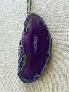 A personal favorite from my Etsy shop https://www.etsy.com/listing/292587187/hand-drilled-purple-agate-slice-necklace