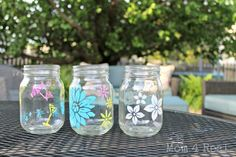 stenciled mason jar votives, crafts, mason jars, outdoor living, Paint a few to give as a Mother s Day gift Mason Jar Projects, Mason Jar Crafts, Mason Jar Diy, Bottles And Jars, Glass Jars, Candle Jars, Candle Holders, Diy Bottle, Bottle Crafts