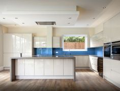 A strip of blue was added into this Remo Beige kitchen by Ice Interiors