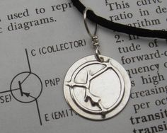 Items similar to PNP Transistor Symbol Silver Pendant, Electronics Science Jewelry, Nerd Necklace, Science Teacher, Computer Science on Etsy Unique Gifts, Best Gifts, Science Jewelry, Nerd, Sterling Silver Pendants, Wire Jewelry, Geek Stuff, Chain, Computer Science