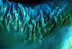 "Ocean Sands, Bahamas    ""From afar, this could look like an abstract painting; however this spectacular satellite image is of the dunes of sand and seaweed, sculpted by the ocean currents. The fluted, underwater dunes are formed in much the same way as sand dunes in deserts."""