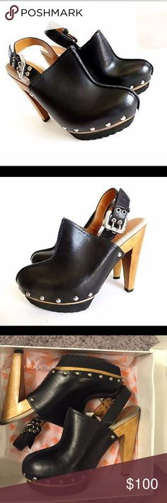 Michael Kors black leather studded clogs Michael Kors Claudia black leather studded clogs..studs are silver clogs are a platform style and also have a  rubber pad for grip..comes with original box Michael Kors Shoes Mules & Clogs