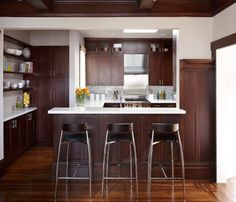 Dark Brown Cabinets White Countertops Orange Wall