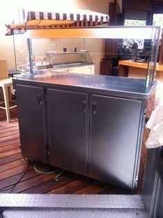 Muebles en acero inoxidable para mantener  los platos calientes. Tenerife