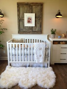 Rustic Nursery. I want the rug and wood hanging