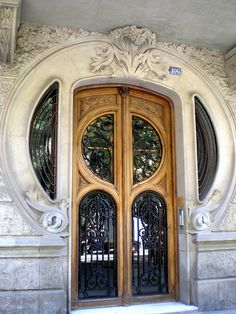 Art Nouveau Door in Barcelona, Spain - photo by Jaume Meneses, via Flickr     ...link doesn't work...