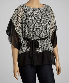 Slink into this fashion-forward number and feel instantly on trend. Boasting an elegant damask print, flattering cape sleeves and a curve-contouring sash-tied waist, it's sure to become a front-of-the-closet favorite.