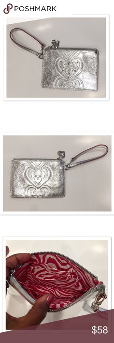 """Brighton Wristlet Silver Brighton wristlet. BNWOT. No flaws! Three interior card slots and one individual slim pocket. Detachable strap. Measures approx 8x5.5"""". Offers welcome. Beautiful shiny and bright silver! Interior has a pink and white pattern. Brighton Bags Clutches & Wristlets"""