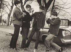 The Beatles filming each other in 1963. Photo by Dezo Hoffman.