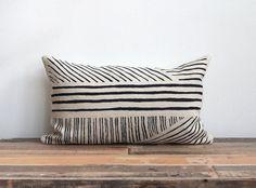 Hand printed lumbar pillow cover in black on natural ecru organic hemp 12x21 Karnataka. $62.00, via Etsy.