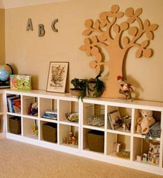 I want to make this!  DIY Furniture Plan from Ana-White.com  Cubby shelves are so loved because they enable you to further divide down your storage spaces. This simple cubby was transformed by one of our amazing readers into this outstanding storage playroom.