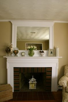 DIY framed mirror over the fireplace! idea-frame large mirror, but hang it-so we can bring it with us-or at least so it's not permanent Fireplace Mantels, Mantles, Fireplace Moulding, Fireplace Mirror, Fireplace Redo, Fireplace Design, Fireplace Ideas, Decorative Fireplace, Fireplace Makeovers