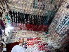 Chen Qingzu uses his collection of 5,000 bras to raise awareness of breast cancer in Sanya, China's Hainan province.