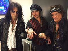 Hollywood vampires- Alice Cooper, Johnny Depp & Joe Perry show of their matching rings backstage at the Grammys 2016