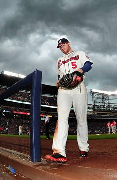 Freddie Freeman #5 of the Atlanta Braves heads off to the dugout during the sixth inning against the Washington Nationals at Turner Field