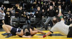 Iowa players and coaches watch as Tony Ramos pins Penn State's Jordan Conaway at Carver-Hawkeye Arena on Friday, Feb. 1, 2013.   David Scrivner / Iowa City Press-Citizen