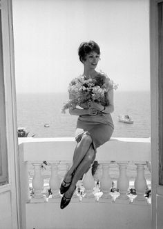 Adorned with a bouquet flowers overlooking the glamorous horizon in Cannes, 1959