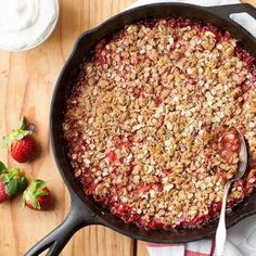 Fresh strawberries and rhubarb meld together under a crisp oat crumble in this gluten-free dessert recipe made in just one skillet.