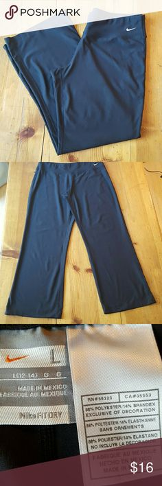 "Nike Fit-Dry Pants Black with small Nike logo front left hip. Size large fit 12-14 inseam 29"" Excellent condition Nike Pants Straight Leg"