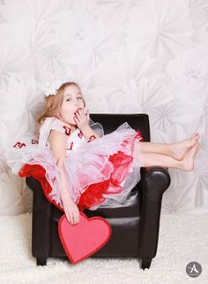 Amanda Abraham Photography specializing in newborn and children portrait photography, using props to enhance your child's next photo session in the Metro Detroit area. Valentine's Day themed photo shoot in studio.