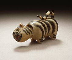 Netsuke: tiger doll Japan, 19th century The Los Angeles County Museum of Art