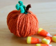yarn pumpkins  We made some of these this weekend and they are SO cute (and easy, too).  I'm making them in my classroom this week.