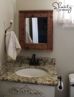 DIY Wooden Mirror! FREE plans and tutorial at Shanty-2-Chic.com
