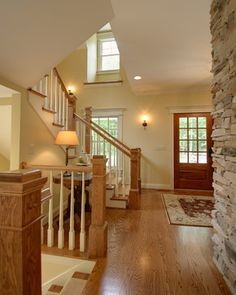 Quiet Casual Home: Entryway and Stair - traditional - staircase - columbus - RTA Studio - Love the wall color with the stained woodwork Once again, white trim Room Paint Colors, Paint Colors For Living Room, Home Design, Design Ideas, Design Trends, Honey Oak Trim, White Baseboards, Stained Trim, Traditional Staircase
