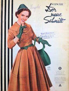An awesome cold weather look starting fox brown and dark green from 1954. #vintage #fashion #dresses #gloves