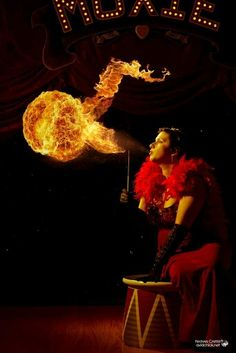 #fire eater I love this picture it looks like a fire fairy or tiny person is jumping out of the flames mini circus performer is on fire