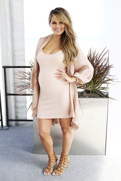 Chrissy Teigen in a nude dress paired with a silky matching duster and finished with cage heels.