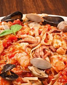 Linguine with Seafood (Linguine ai Frutti di Mare): A favorite of seafood lovers, our version of this classic pasta dish combines shrimp, scallops, squid, tilapia, clams and mussels with a simple marinara sauce served over linguine.