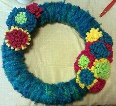 Yarn wreath with felt flowers.