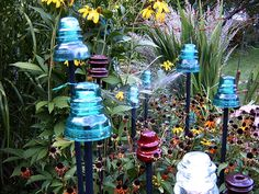 Gardening with telegraph insulators - I have lots of these! Might have to try them in the garden now.