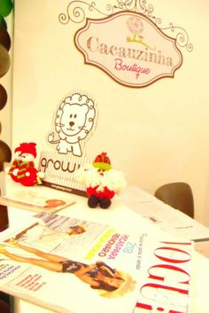 Foto do Interior da Loja Cacauzinha Boutique.