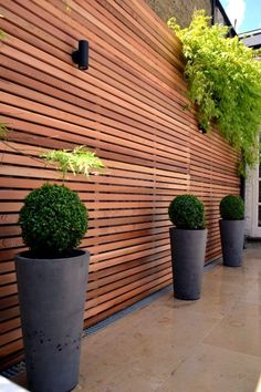 Tall horizontal wood privacy fence