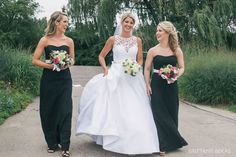 Perfect Summer Day Wedding: Strapless black gowns for the bridesmaids. // Seven Bridges Golf Club | Brittany Bekas Photography