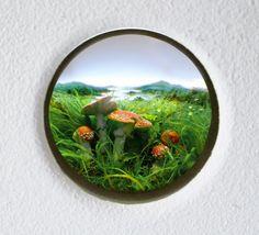 Patrick Jacobs Magnified Portals into Miniature Worlds -- Diorama viewed through 7.5 in. (19 cm) window. Styrene, acrylic, cast neoprene, hair, paper, ash, talc, starch, polyurethane foam, vinyl film, wood, steel, lighting, BK7 glass.