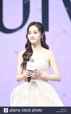 Download this stock image: Chinese singer Wu Xuanyi of South Korean-Chinese girl group Cosmic Girls and Chinese girl group Rocket Girls 101 attends a promotional event in Shangh - W5FGAC from Alamy's library of millions of high resolution stock photos, illustrations and vectors.